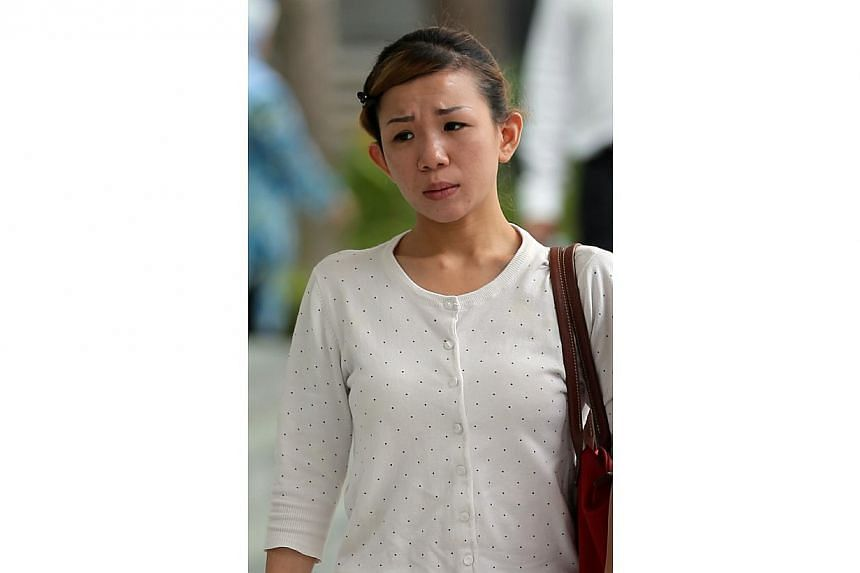 Ho Mei Li, 28, was sentenced to 3 weeks jail for maid abuse by using her leg to step on her chest.-- ST PHOTO:WONG KWAI CHOW