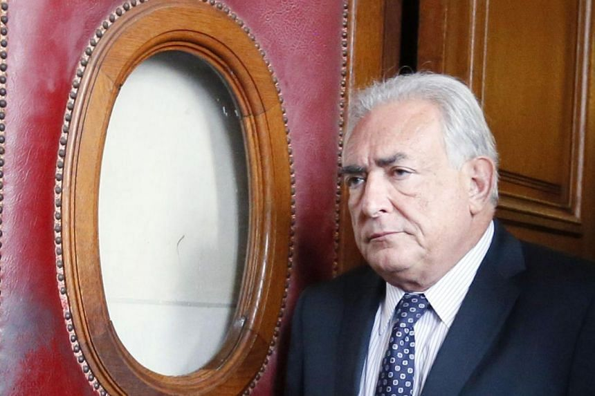 """Dominique Strauss-Kahn was charged with """"aggravated pimping in an organised group"""" after his name came up as part of an investigation into a prostitution ring in northern France and Belgium. -- PHOTO: AFP"""