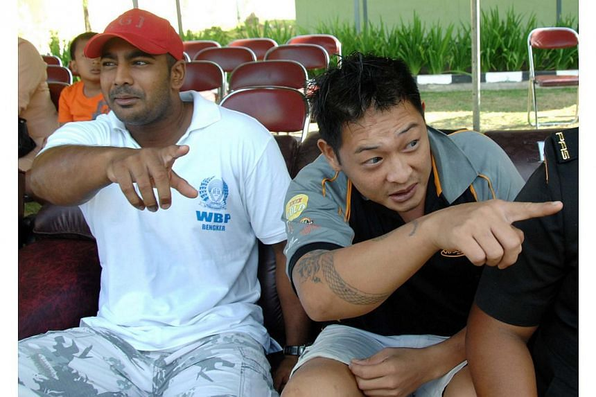 In this file photo taken on Aug 17, 2010, convicted Australian drug smugglers Myuran Sukumaran (left) and Andrew Chan (right) sit inside Kerobokan prison in Denpasar, Bali. Chan on death row in Indonesia has lost his appeal for presidential clemency,