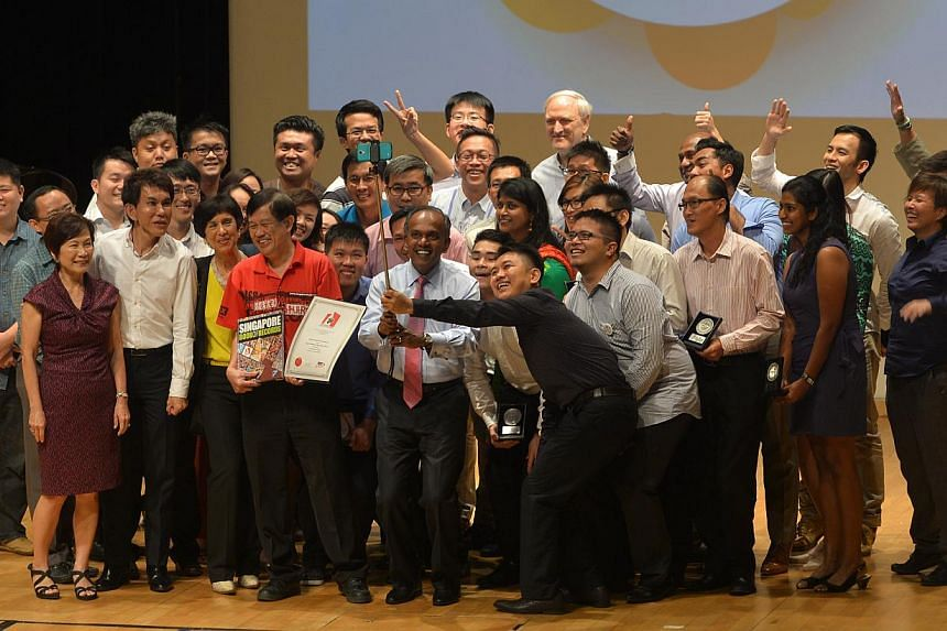 "Minister K Shanmugam (front, with pink tie) takes part in a ""we-fie"" on stage as bone marrow donors set a Guinness record for the largest number of bone marrow donors in the same place at the Raffles Institution on Jan 30, 2015. -- ST PHOTO: ALPHONSU"