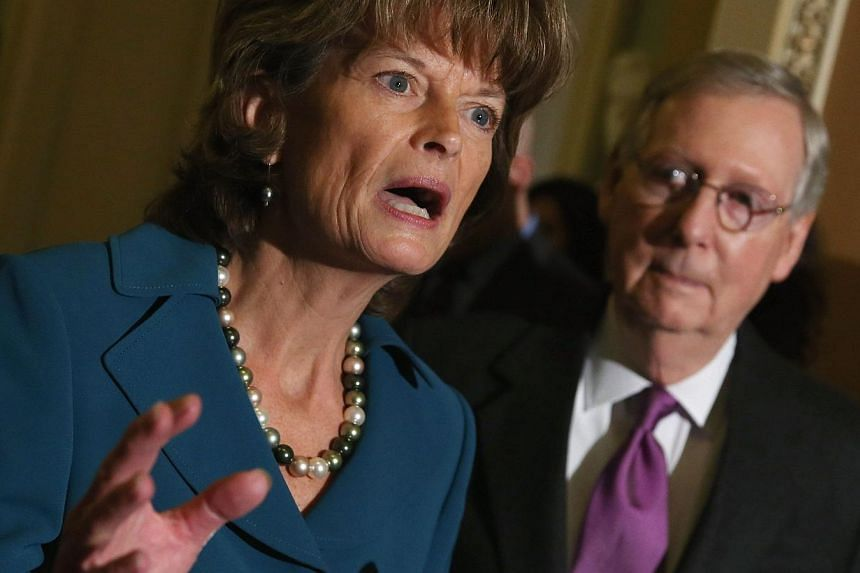 Republican Senator Lisa Murkowski speaks while flanked by Majority Leader Mitch McConnell on Jan 29, 2015 at the US Capitol in Washington, DC. The US Senate on Thursday approved the immediate construction of the controversial Keystone XL oil pipeline