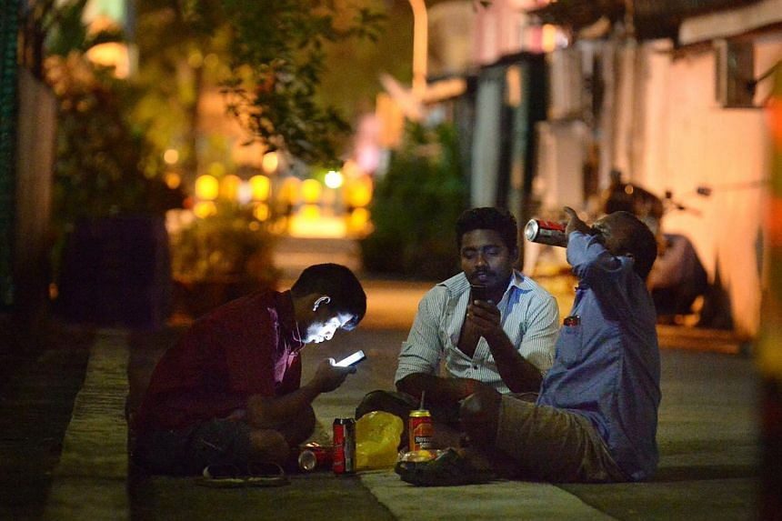 Foreign workers gather in twos and threes to drink beer in the quiet alleys of Geylang on a Sunday night on Jan 18, 2015. Mr Hri Kumar Nair (Bishan-Toa Payoh GRC), who chairs the Government Parliamentary Committee for Home Affairs and Law, said