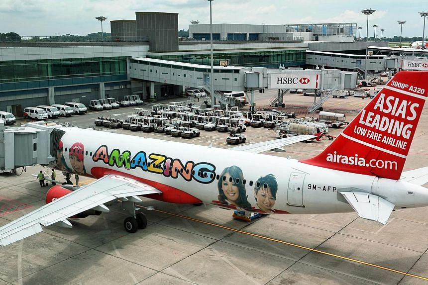 Budget airline AirAsia Bhd resumed online promotions and advertising this week, a month after a plane operated by its Indonesia affiliate crashed into the Java Sea, killing all 162 people on board.An AirAsia aircraft at Changi Airport Terminal