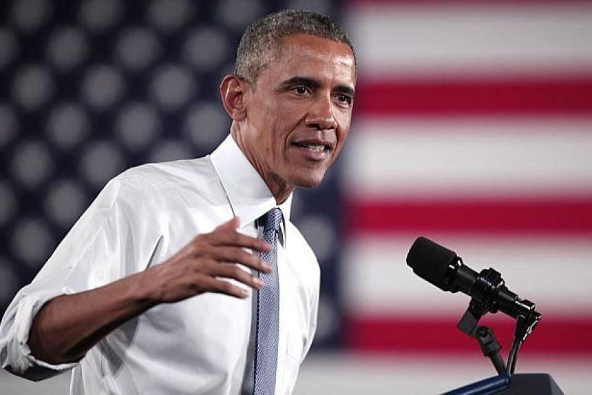 """US President Barack Obama's (above) fiscal 2016 budget proposes a roughly 7 per cent increase in spending over mandatory levels set in spending caps known as """"sequestration,"""" a White House official said on Thursday. -- PHOTO: AFP"""