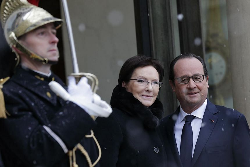French President Francois Hollande (right) welcomes Poland's Prime Minister Ewa Kopacz at the Elysee Palace in Paris, Jan 30, 2015. -- PHOTO: REUTERS