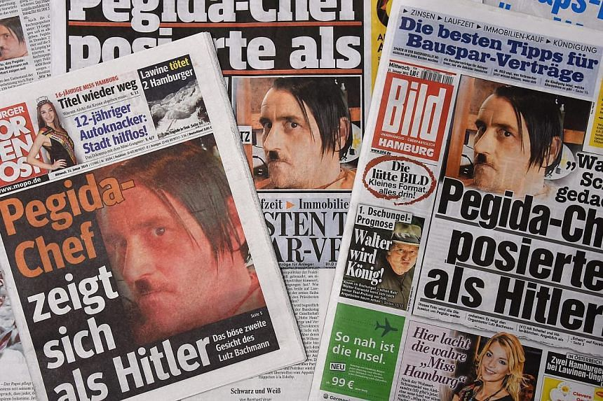"""The front pages of German daily newspapers showing pictures of ex-Pegida head Lutz Bachmann sporting a """"Hitler"""" moustache on Jan 21, 2015.The German anti-Islam group Pegida, whose rallies have brought up to 25,000 onto the streets of Dresden in"""