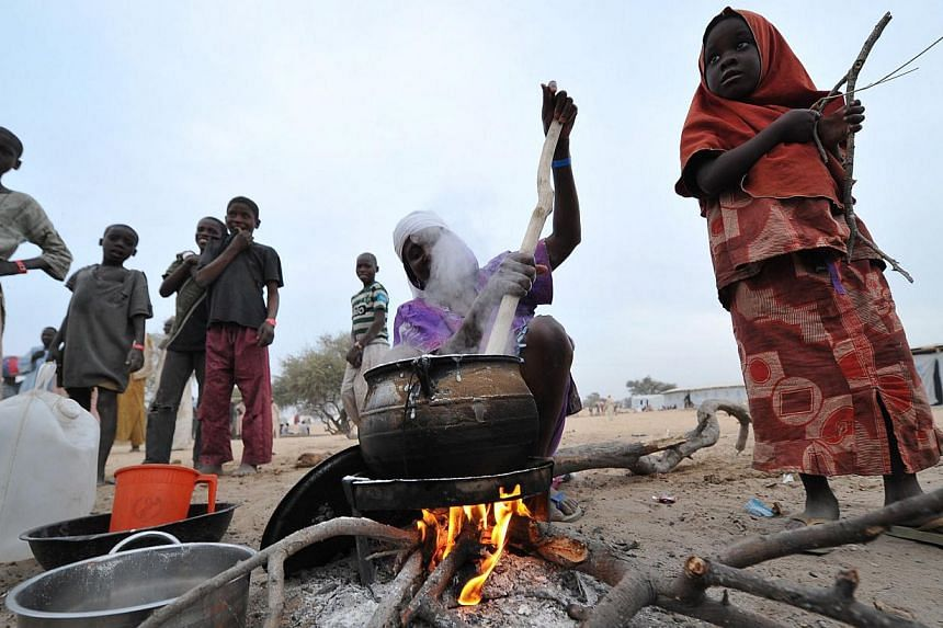 Nigerian refugees prepare food and go about their daily lives at a United Nations High Commission for Refugees camp in Baga Sola on Jan 29, 2015. The refugees arrived in the camp after the attack by Boko Haram millitants in the Nigerian town of Baga.