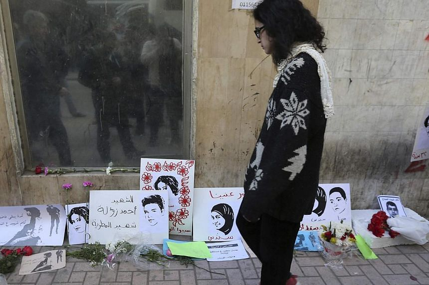 A woman looks at mementos left at the spot where activist Shaimaa Sabbagh died during a protest on Saturday, in central Cairo Jan 29, 2015.Tensions have been raised across Egypt this week by protests, some of them violent, marking the anniversa
