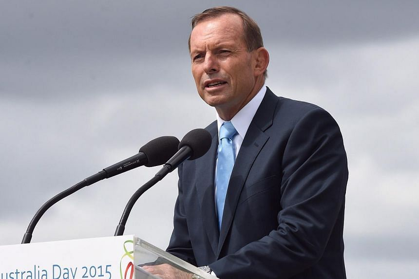 Australian Prime Minister Tony Abbott speaks during the Australia Day celebrations in Canberra, Australia on Jan 26, 2015. Australia's opposition Labor party pulled off an electoral upset on Saturday and looks set to oust the ruling Liberal-Nati