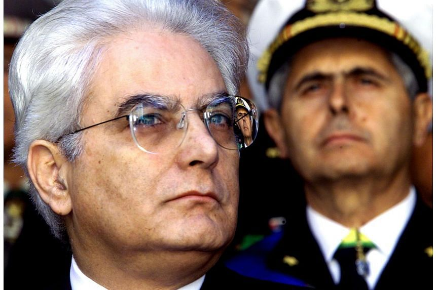An undated picture made available on Jan 29, 2015 of Sergio Mattarella (left) at an undisclosed location. Italian lawmakers elected Sergio Mattarella, a constitutional court judge and veteran centre-left politician, as president on Saturday, handing