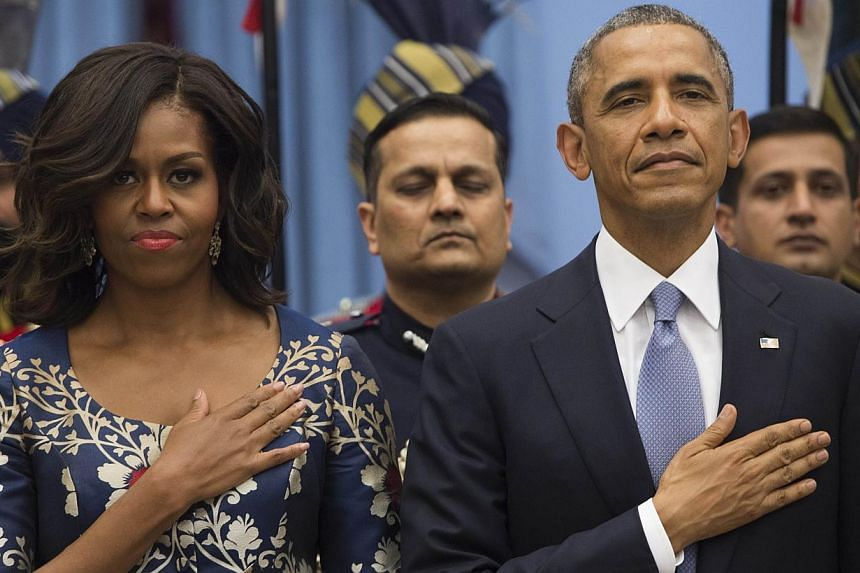 US President Barack Obama and First Lady Michelle Obama stand for the American National Anthem before a State Dinner in New Delhi, India on Jan 25, 2015. -- PHOTO: AFP
