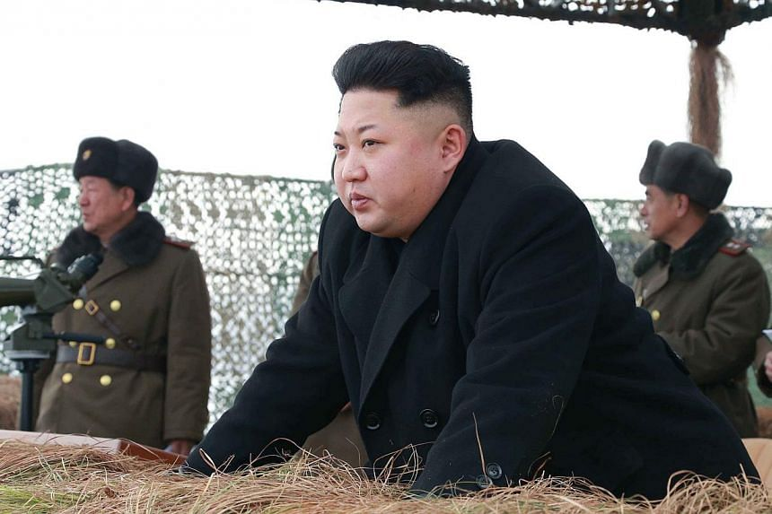 North Korean leader Kim Jong Un gives a field guide during a winter river-crossing attack drill of the armored infantry sub-units of the motorized strike group in the western sector of the front of the Korean People's Army (KPA) in this undated photo
