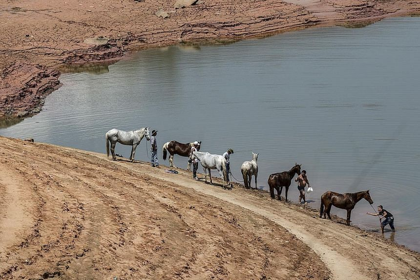 Water at an all-time low in the Jaguari reservoir in Brazil's Sao Paulo state last November. There are signs of water problems all over the globe.