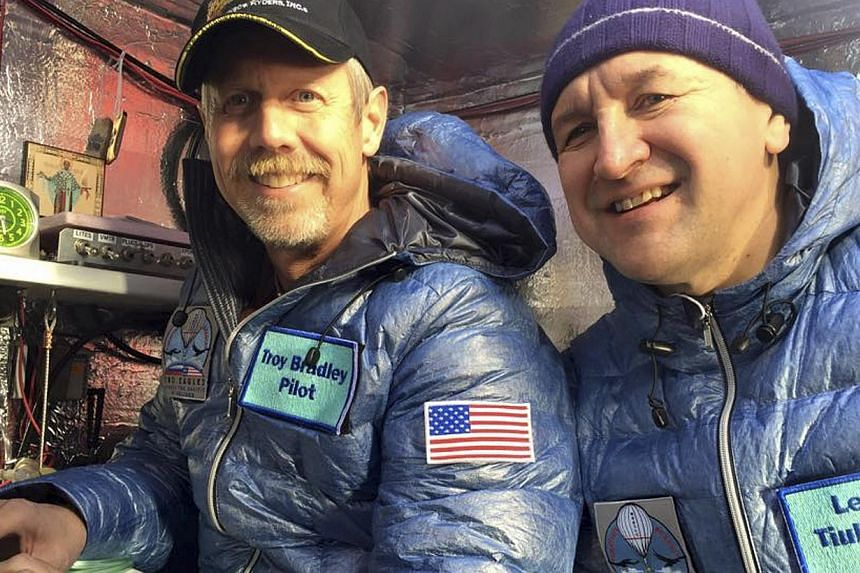 Pilots Troy Bradley (left) of the US and Leonid Tiukhtayev of Russia sit in the capsule of the Two Eagles balloon before their departure on Jan 25, 2015. The pair completed a world record-breaking trans-Pacific flight on Saturday after splashing down
