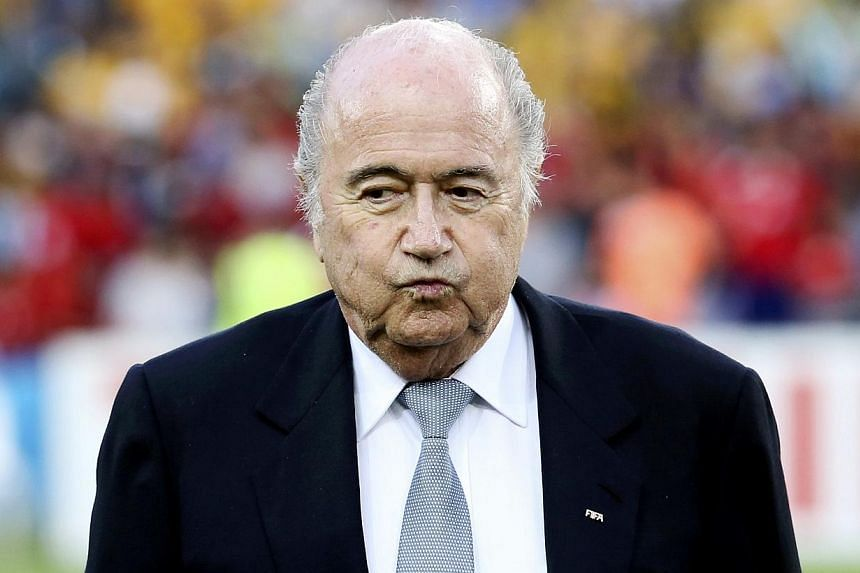 Fifa president Sepp Blatter reacts before the Asian Cup final soccer match between South Korea and Australia at the Stadium Australia in Sydney, where he was booed by fans, on Jan 31, 2015. -- PHOTO: REUTERS