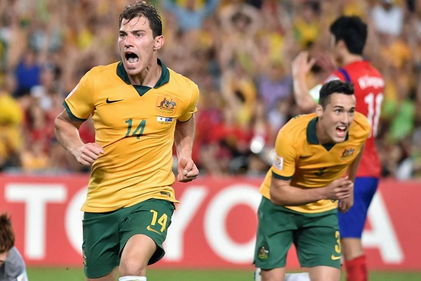 Australia's James Troisi (left) celebrates scoring during the AFC Asian Cup football final between South Korea and Australia at Stadium Australia in Sydney on Jan 31, 2015. -- PHOTO: AFP