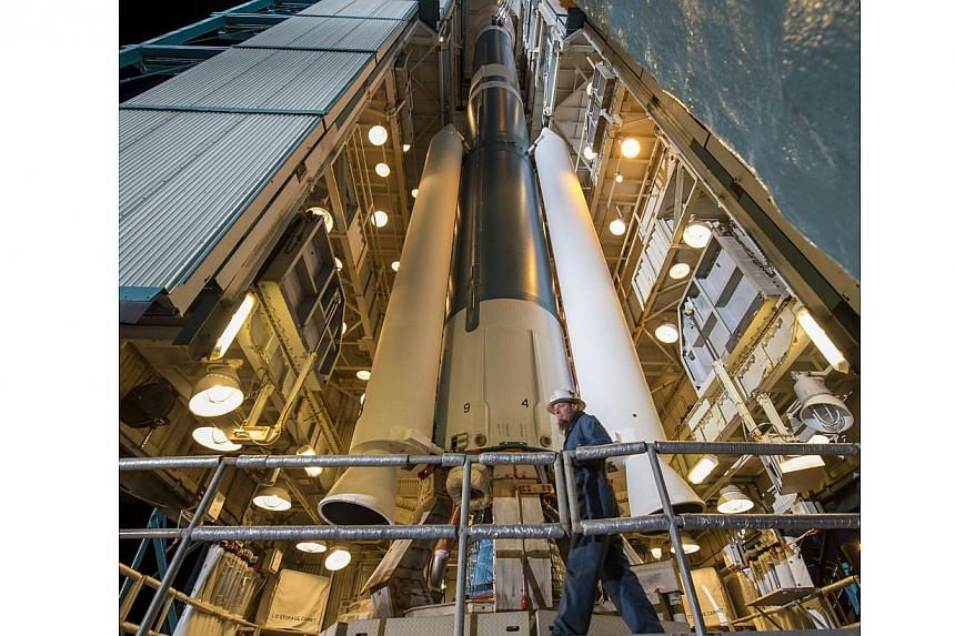 This NASA photo released on Jan 29, 2015, a worker preparing the launch gantry to be rolled back from the United Launch Alliance Delta II rocket with Soil Moisture Active Passive (SMAP) observatory onboard, at the Space Launch Complex 2, on Jan 28, 2
