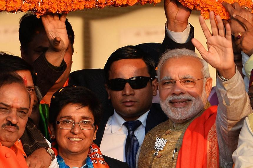 Indian Prime Minister Narendra Modi (right) and leader of the right-wing Bharatiya Janata Party (BJP), gestures as he adresses a public rally in New Delhi on Jan 31, 2015. -- PHOTO: AFP