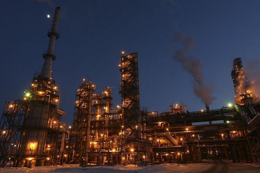 A general view of the Bashneft-Ufaneftekhim oil refinery is seen outside Ufa, Bashkortostan on Jan 29, 2015. Russian Economy Minister Alexei Ulyukayev said the ministry sees the country's economy shrinking 3 per cent in 2015 and inflation of 12 per c
