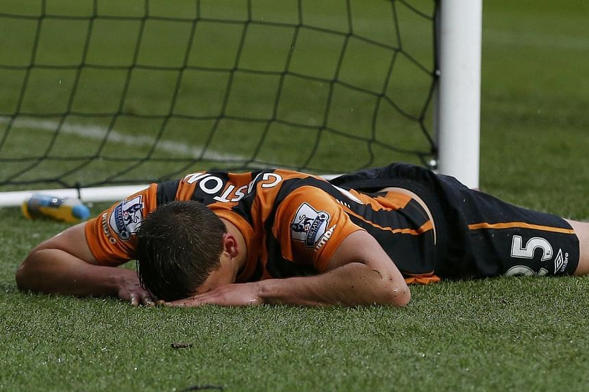 Hull City's Gaston Ramirez reacts after missing a chance to score during their English Premier League soccer match against Newcastle United at the KC Stadium in Hull, northern England on Jan 31, 2015. -- PHOTO: REUTERS