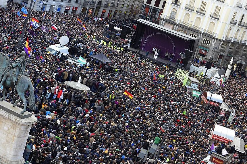 Tens of thousands of people took to the streets in Madrid on Saturday (above) in support of new anti-austerity party Podemos, a week after Greece elected its hard-left ally Syriza.-- PHOTO: AFP