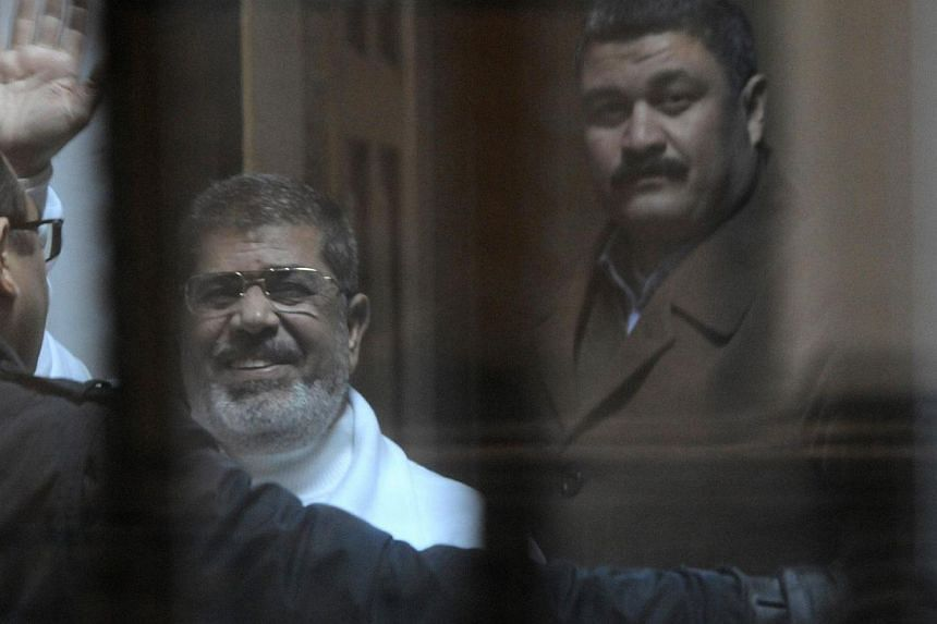 An Egyptian court set May 16 for a verdict in the espionage trial of ousted president Mohamed Morsi (above), who could be sentenced to death if convicted, an official said Saturday. -- PHOTO: AFP