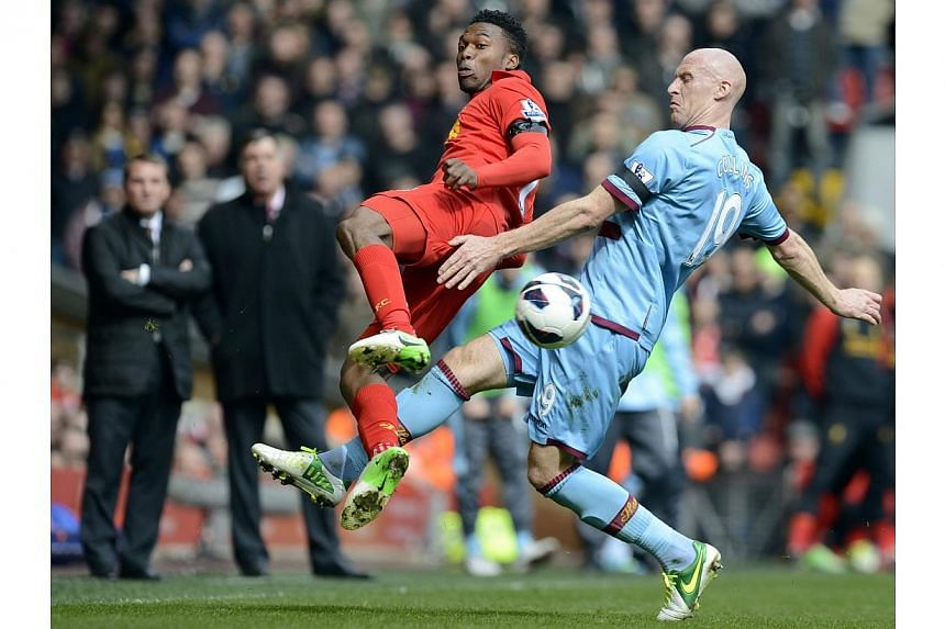 West Ham United's James Collins (right) challenges Liverpool's Daniel Sturridge during their English Premier League soccer match at Anfield in Liverpool, northern England on April 7, 2013. Liverpool striker Daniel Sturridge says he is ready to s
