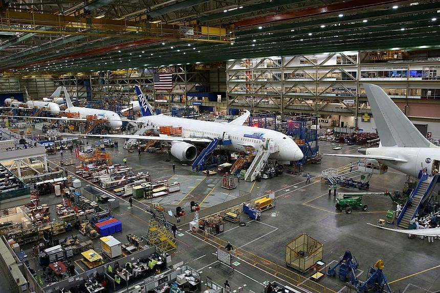 The Boeing 787 Dreamliner assembly line in Seattle, USA, on Jan 29, 2015. Budget carrier Scoot marked a new chapter in its history, after it collected the first of its Boeing 787 jets on Sunday. -- ST PHOTO: WANG HUI FEN
