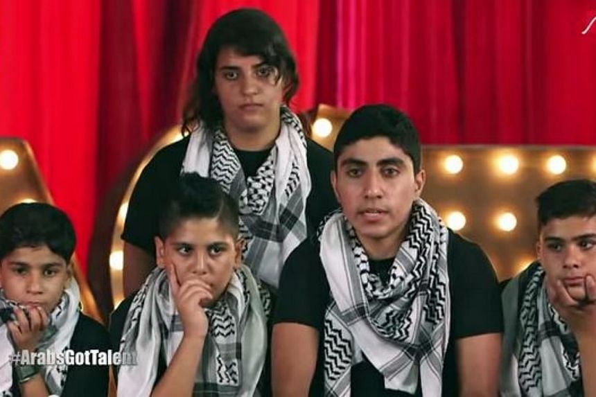 """The five young musicians in chequered black-and-white scarves who brought the house on the hugely popular """"Arabs Got Talent"""" TV show in Beirut last month. -- PHOTO: SCREENGRAB FROM YOUTUBE"""