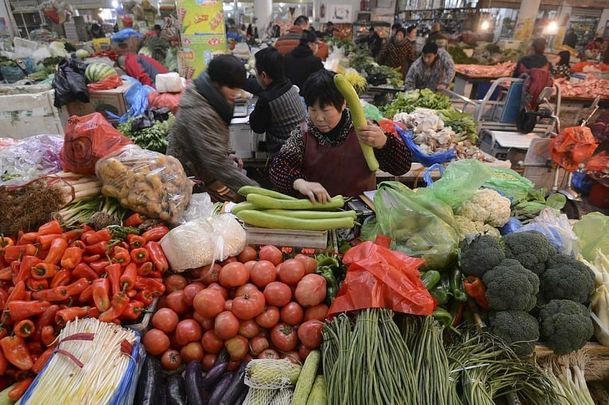 China has promised to address food safety issues and modernise its agriculture as policy priorities this year, said the nation's 2015 agenda for rural matters on Sunday, Feb 1, 2015, according to state news agency Xinhua. -- PHOTO: REUTERS