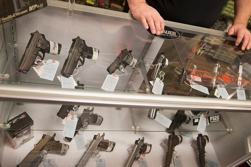 Customers shop for a handgun at Metro Shooting Supplies on Nov 12, 2014 in Bridgeton, Missouri.A three-year-old boy in New Mexico shot his parents after being left within reach of a gun, the latest in a spate of firearm-related tragedies involv