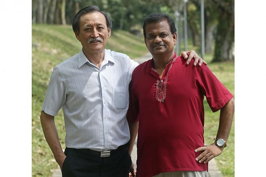 Ng Moi Song (left), 61, and Gurusamy Selvaraj (right), 58, are among the residents who was featured in the book Chronicles of Remembrance. -- ST PHOTO: SEAH KWANG PENG