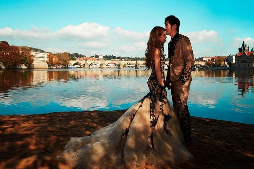 Hannah Quinlivan dons a frothy gown in this shot where the couple is pictured against a spectacular backdrop of Charles Bridge in Prague.-- PHOTO: JAY CHOU/FACEBOOK