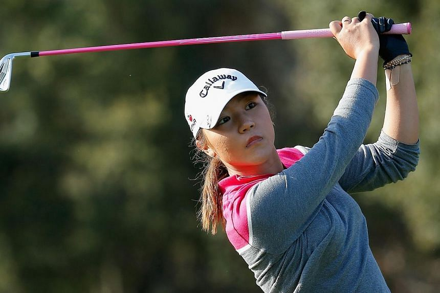 Lydia Ko of New Zealand watches her tee shot on the 15th hole at the Coates Golf Championship at the Golden Ocala Golf & Equestrian Club on Jan 31, 2015 in Ocala, Florida. -- PHOTO: AFP