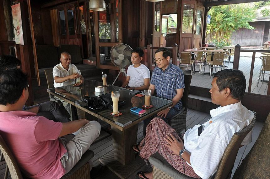 Customers enjoying coffee at one of Yangon's new specialty coffee joints on Jan 27, 2015. -- PHOTO: AFP