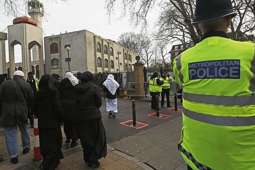 Police carry out a regular patrol as worshippers arrive at the London Central Mosque at Regent's Park in London on Jan 9, 2015.Some 20 mosques in Britain were opening their doors to the public on Sunday, Feb 1, in an unprecedented gesture of re