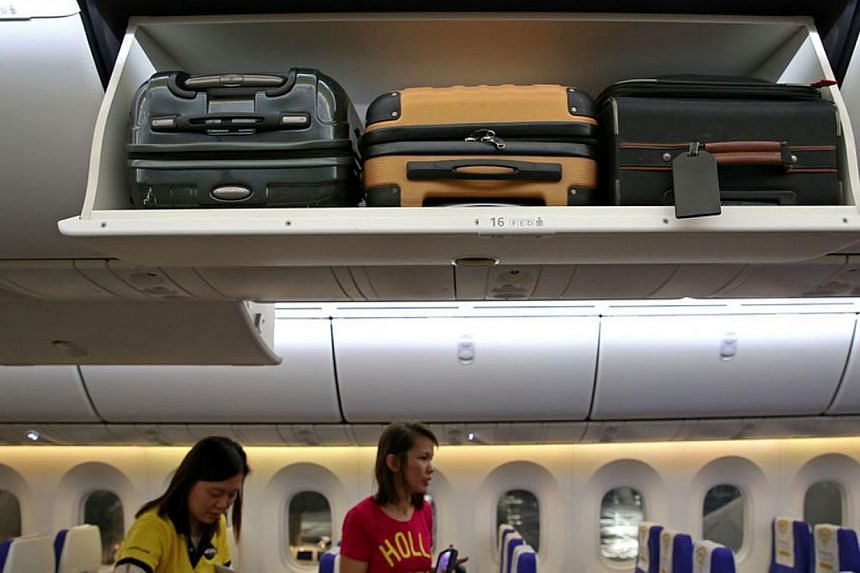 Larger overhead bins ensure every passenger has a place for their carry-on luggage. -- ST PHOTO: WANG HUI FEN