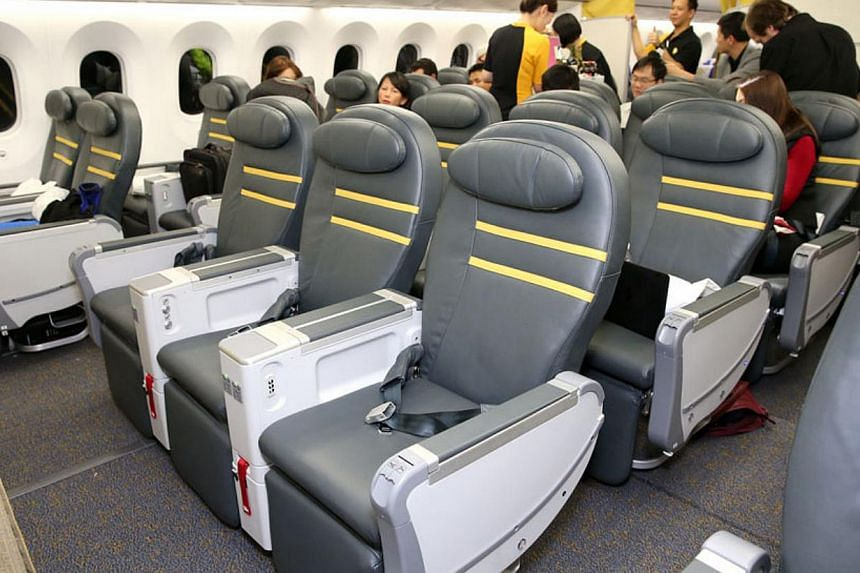 """35 all-leather premium seats, arranged in a 2-3-2 configuration, areenhanced to include an extendable leg-rest and a """"cradle"""" recline position.-- ST PHOTO: WANG HUI FEN."""