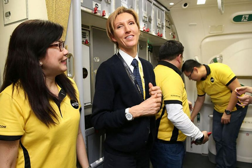 Captain Eva Marie met her passengers briefly before going into the cockpit. -- ST PHOTO: WANG HUI FEN