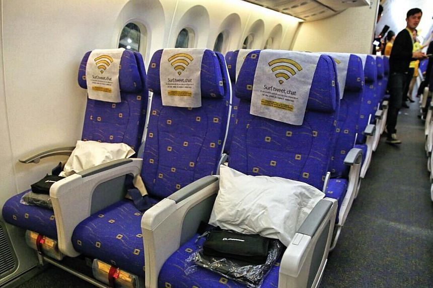 The economy-class seats on Scoot's new Dreamliner. -- ST PHOTO: WANG HUI FEN