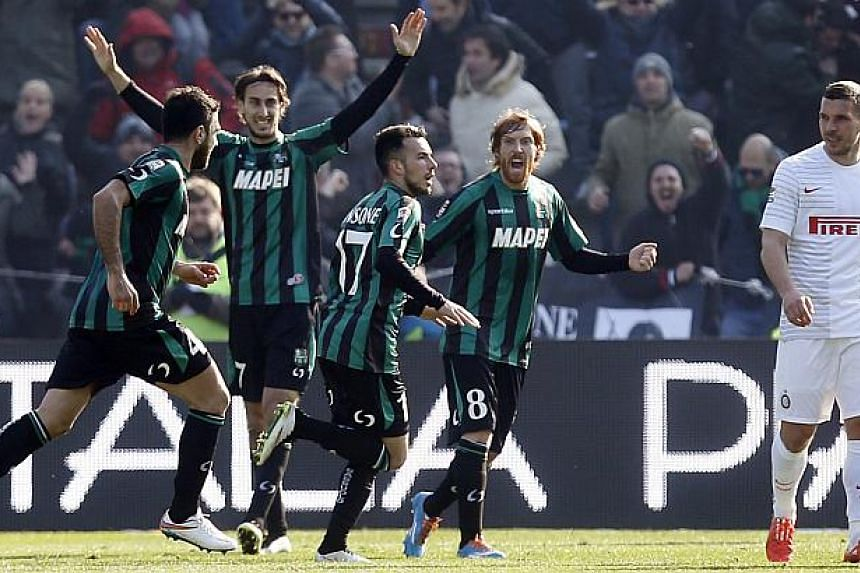 Sassuolo's Nicola Sansone (third, left) celebrates after scoring a goal against Inter Milan during their Italian Serie A soccer match at the Mapei stadium in Reggio Emilia on Feb 1, 2015. Sassuolo defeated Inter Milan 3-1, with both sides finish