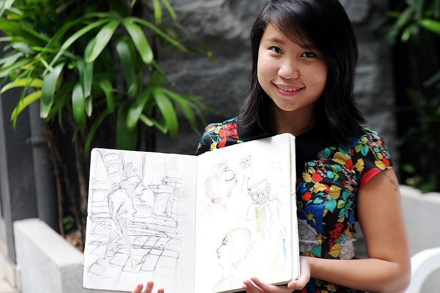 Ms Vicky Chen kept a scrapbook with sketches and photos of her eight months in Europe. --ST PHOTO: TIFFANY GOH