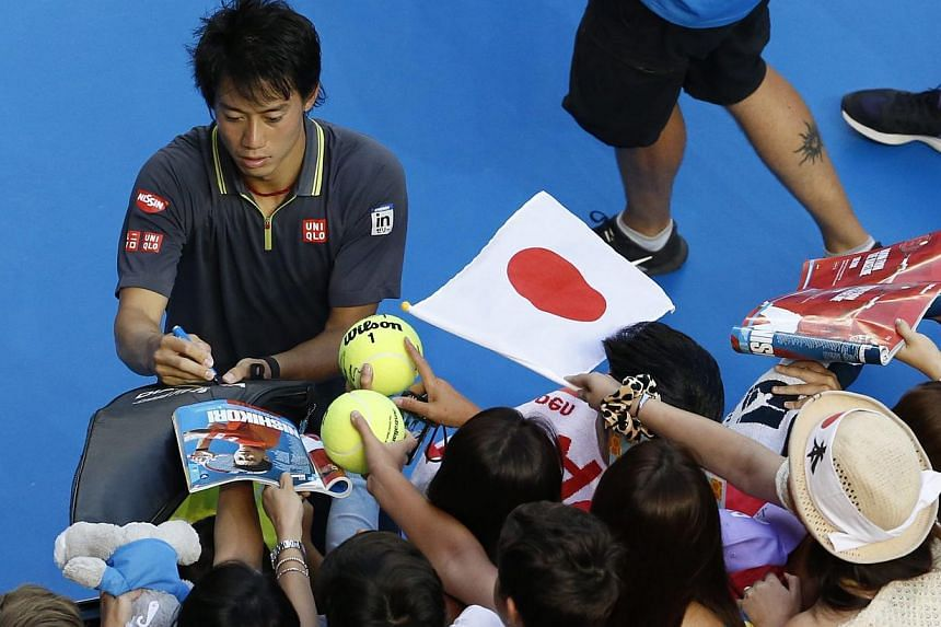 Kei Nishikori, signing autographs at the Australian Open, is a national hero in Japan where his fans include older women who like his open, honest image.