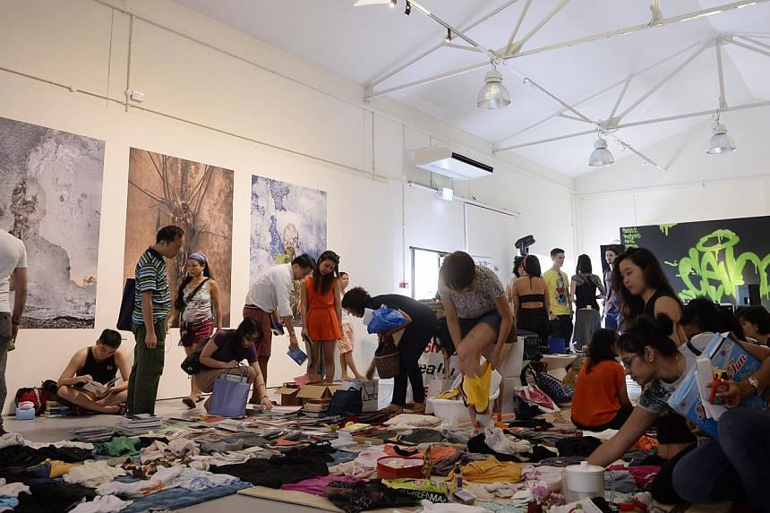 People browse around the Singapore Really Really Free Market during The Mill x WeJungle: Destruction & Rebirth at Jalan Kilang on on Jan 21, 2015. -- ST PHOTO: MARK CHEONG