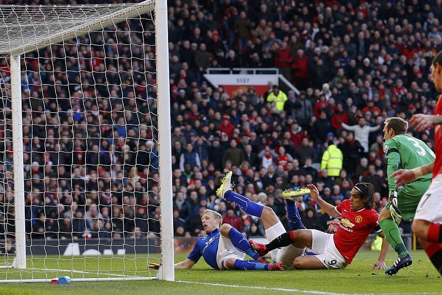 Manchester United's Radamel Falcao (centre) taps the ball in to score during their English Premier League soccer match against Leicester City at Old Trafford in Manchester, northern England Jan 31, 2015. -- PHOTO: REUTERS