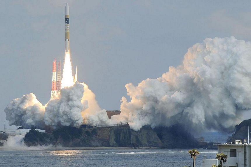 A H-IIA rocket, carrying a backup radar satellite for intelligence gathering by the government, lifts off from the launching pad at Tanegashima Space Center on the Japanese southwestern island of Tanegashima, in this photo taken by Kyodo on Feb 1, 20