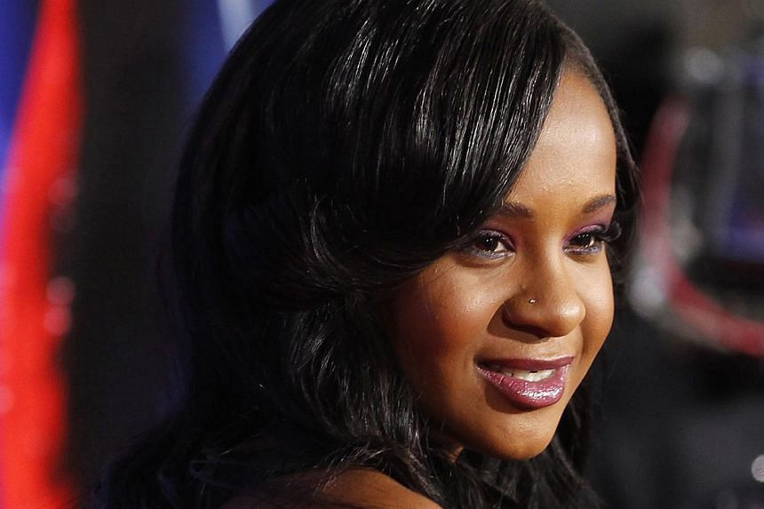 "Bobbi Kristina Brown, daughter of the late singer Whitney Houston, poses at the premiere of ""Sparkle"" in Hollywood, California, in this file photo taken on Aug 16, 2012. She was found unconscious in a bathtub at her home on Saturday and has since bee"