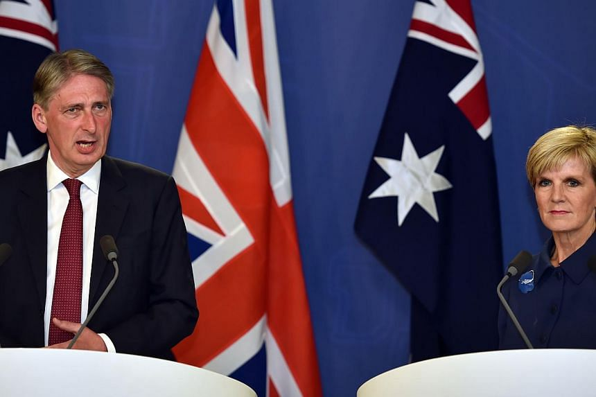 British Secretary of State for Foreign and Commonwealth Affairs Philip Hammond (left) speaking to reporters with Australian Foreign Minister Julie Bishop during defence talks in Sydney on Feb 1, 2015.The two foreign ministers slammed the killin