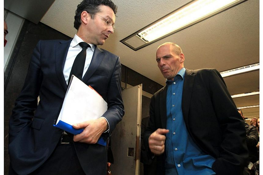 A sartorial shift in gear is among the most obvious changes with Greece's new government, as seen at Friday's meeting between untucked Finance Minister Yanis Varoufakis (above right) and the sharp-suited head of the Eurogroup, Jeroen Dijsselbloem (ab
