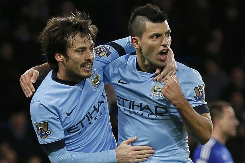 Manchester City's David Silva (left) celebrates his goal with teammate Sergio Aguero during their English Premier League soccer match against Chelsea at Stamford Bridge in London Jan 31, 2015. -- PHOTO: REUTERS